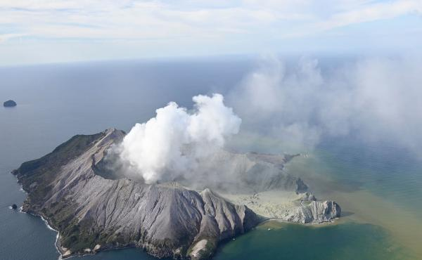 Smoke billows from White Island after a volcanic eruption on Monday. Officials say some people remain unaccounted for and it remains too dangerous for emergency services to access the island.