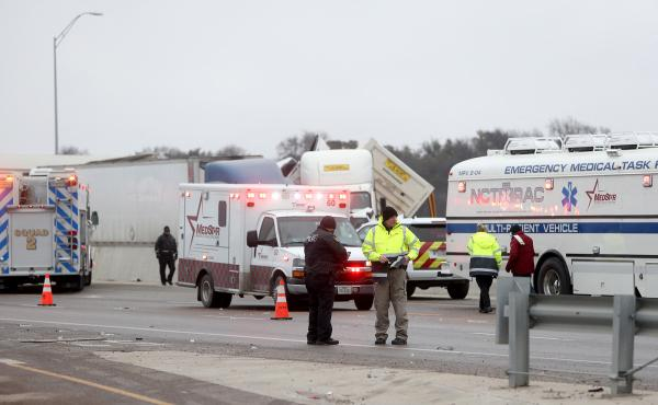 First responders arrive at the scene of a massive pileup of vehicles on Interstate 35W near downtown Fort Worth, Texas, on Thursday.