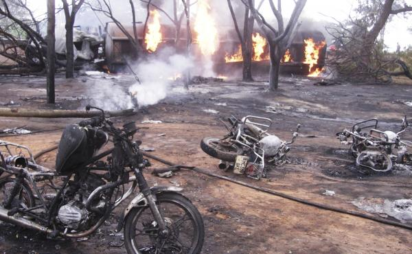 A damaged tanker truck exploded in Tanzania on Saturday as people were trying to siphon fuel out of it, killing at least 62.