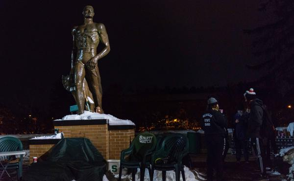 Legend has it that some University of Michigan fans defaced the statue sometime in the 1960s, and that led to members of the Michigan State University band and other students, sitting vigil.