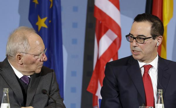 U.S. Treasury Secretary Steven Mnuchin, right, and German Finance Minister Wolfgang Schaeuble, left, address the media during a joint press conference in Berlin, Germany, on Thursday in advance of the weekend's G20 summit.