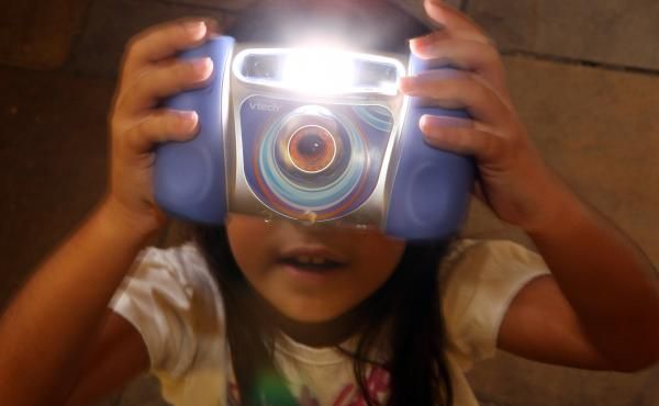 Charlize, 8, plays with the Kidizoom Multimedia Digital Camera made by VTech in 2009. A recent data breach hacking sensitive information, including kid's photos, is prompting parents to look twice at their children's technology usage.