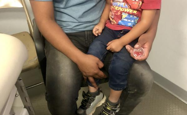 Sergio, a Guatemalan migrant, recently visited a mobile medical van with his 2-year-old son, Dylan. Sergio thinks his son became sick in a holding facility, where they spent two days.