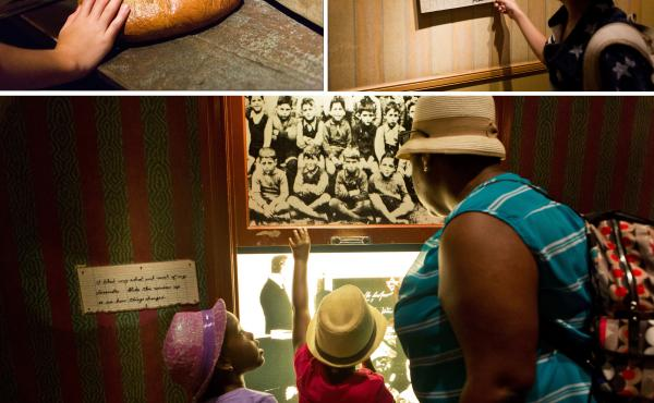 (Top left) A loaf of bread that Daniel's family ate for their meals while they lived in the ghetto. (Top right) Aiden reads one of Daniel's diary entries. Twin sisters Nicolette and Victoria Dejour, 6, look through a window displaying scenes of Germany wi