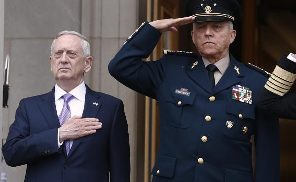 Former Defense Secretary Jim Mattis, left, and former Mexican Defense Secretary Salvador Cienfuegos Zepeda at the Pentagon in 2017. A U.S. district judge dropped drug charges against Cienfuegos Wednesday.
