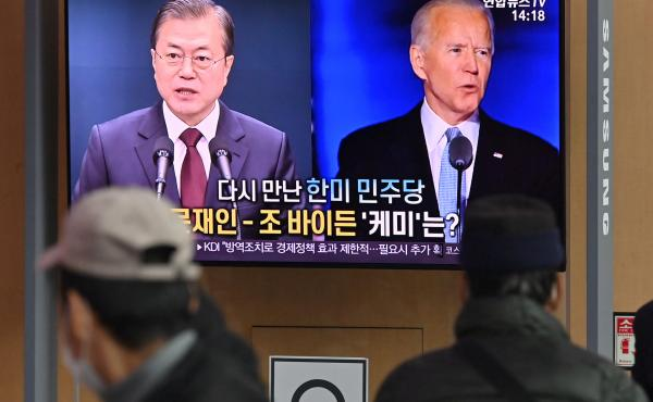 People in Seoul watch a news report in November on the U.S. election, showing images of Joe Biden, newly elected as president, and South Korean President Moon Jae-in.