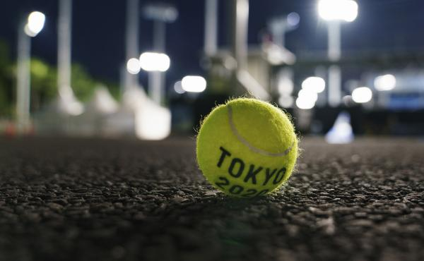 A ball sits outside a court at the Ariake Tennis Park during practice sessions at the Tokyo Olympics on Tuesday.