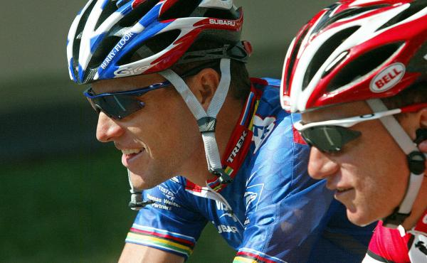 Lance Armstrong (left) and Tyler Hamilton compete in the 90th Tour de France in 2003. Hamilton later testified in the doping case brought against Armstrong and the U.S. Postal cycling team.