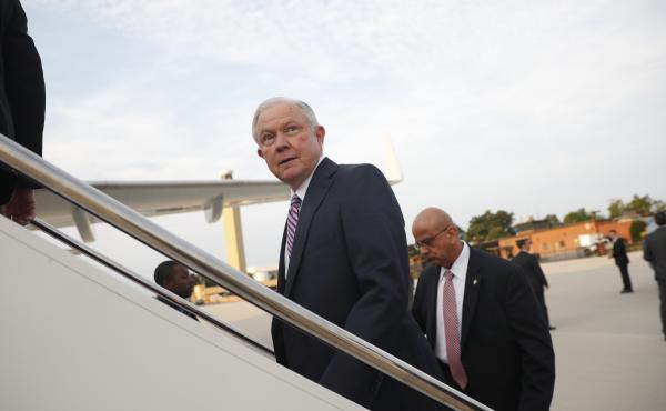 Attorney General Jeff Sessions boards a plane at Andrews Air Force Base, Md., Thursday, for El Salvador. His former Senate colleagues are rallying behind him amid withering attacks from President Trump.