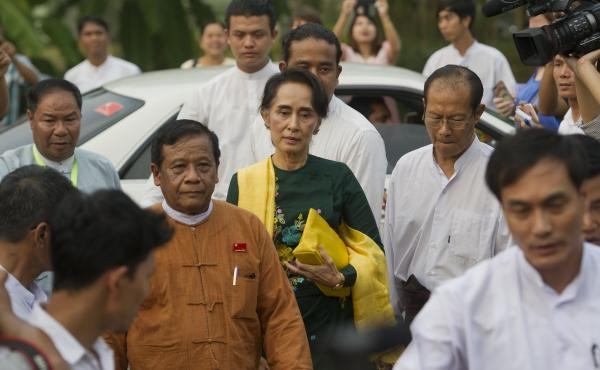 Myanmar's Aung San Suu Kyi, seen here arriving for a party meeting Thursday, is expected to be closely involved in the incoming president's decisions.