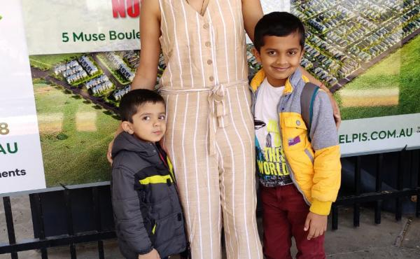 """Poornima Peri, who lives in Melbourne, Australia, with her two sons. Aarit (left), now age 4, is India staying with his grandmother. His mother had planned to pick him up but """"from March [2020] onward it was total lockdown,"""" she says. Because of continuin"""