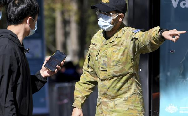 Australian Defense Force personnel assist the public at a COVID-19 vaccination clinic in Sydney, Wednesday, Aug.18th. Australia's most populous state reported a record 633 new infections on Wednesday.