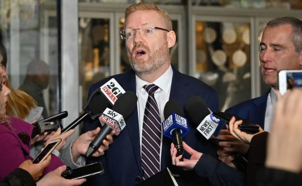 ABC editorial director Craig McMurtrie speaks to the media as Australian police raided the headquarters of the Australian Broadcasting Corp. in Sydney on Wednesday. ABC executives said police executed a search warrant targeting three journalists involved