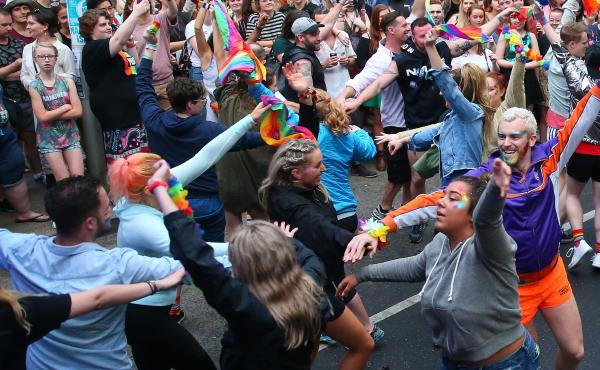 "A flash mob performs in front of supporters of the ""yes"" vote for marriage equality at Melbourne's Result Street Party in Melbourne, Australia, on Wednesday."