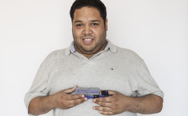 Arnaldo holds a toy truck, his stim toy.