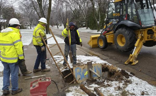 A Madison Water Utility Crew works to dig up and replace a broken water shutoff box in preparation for a larger pipe-lining project. Madison started using copper instead of lead pipes in the late 1920s.