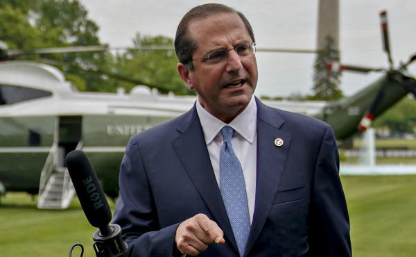 "In an apparent reference to China, Health and Human Services Secretary Alex Azar says a member state of the World Health Organization ""made a mockery of their transparency obligations, with tremendous costs for the entire world."" Azar is seen here last we"