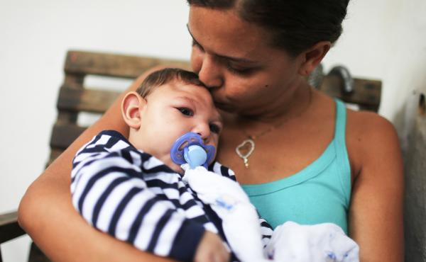 Mother Daniele Santos holds her baby Juan Pedro, who has microcephaly, on May 30, 2016, in Recife, Brazil. Researchers are now learning that Zika's effects can appear up to a year after birth.