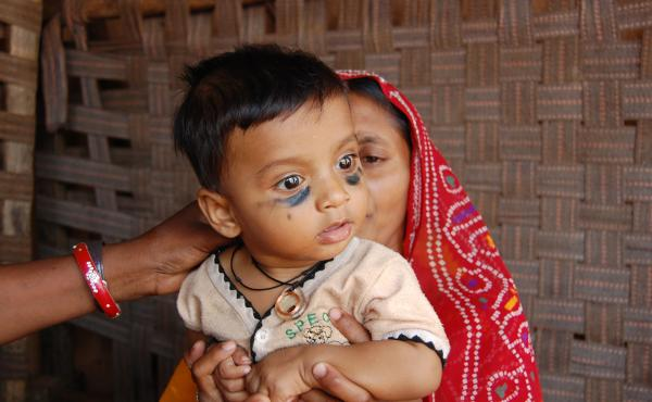 Vikram is the first child to wear a Khushi Baby necklace, which will keep track of his immunizations. He's at a vaccine clinic in Rajasthan, India.