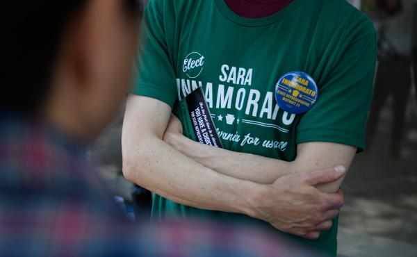 A campaign worker wears a shirt in support of Sara Innamorato outside a polling location at the Oakmont United Methodist Church in Pittsburgh. The first-time candidate declared victory over a five-term incumbent in the Democratic primary for House Distric