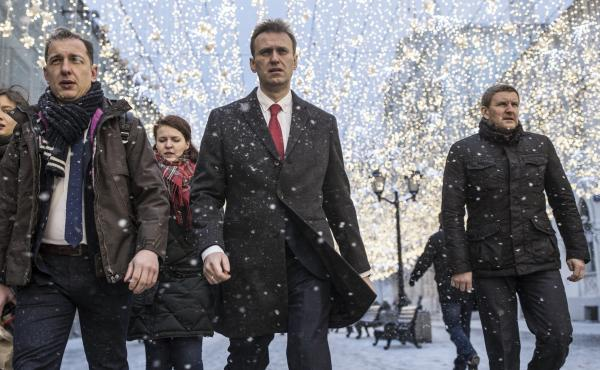 Russian opposition leader Alexei Navalny, center, heads to meeting of the Russia's Central Election commission on Dec. 25 in Moscow. Officials formally barred him Alexei Navalny from running for president in the March 18 election, which he says is a prede