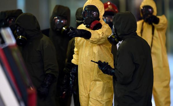 Members of Malaysia's hazardous materials team conduct a decontamination operation at the Kuala Lumpur International Airport on Sunday.