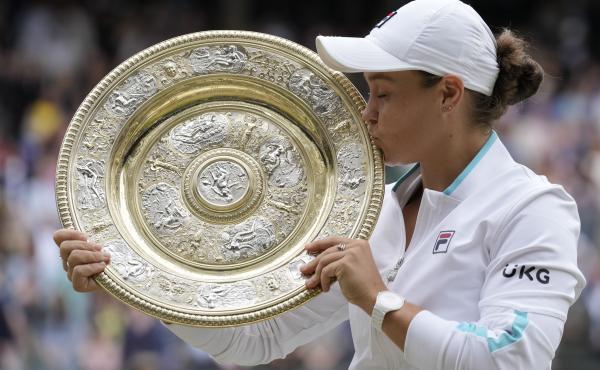 Australia's Ashleigh Barty poses with the winner's trophy on Saturday after winning the Wimbledon women's singles final against the Czech Republic's Karolina Pliskova.