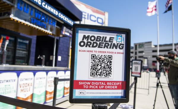 A mobile ordering sign is seen on March 30 at a vending station in Nationals Park, home of the Washington Nationals. The Nats, along with many other teams in baseball, are implementing new safety protocols, including for ordering food, as a new season kic