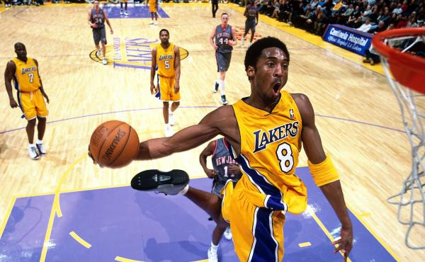 Kobe Bryant goes in for a dunk against the New Jersey Nets during a game at the Staples Center in Los Angeles on Jan. 1, 2001.