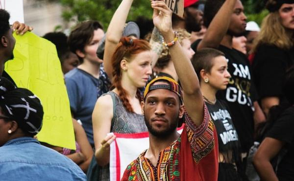 Akeem Muhammad stands with a group of protesters in Baton Rouge, La., on Sunday. The 24-year-old student was one of more than 120 people who were arrested during the protest.