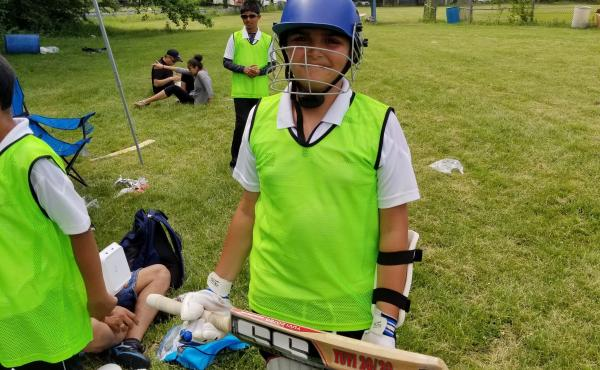 Arjun Rath, 11, armored up and ready to bat.
