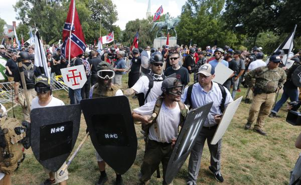 Alt-right demonstrators clash with counter-demonstrators at the entrance to Lee Park in Charlottesville, Va., on Aug. 12.