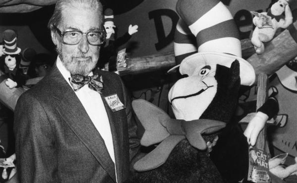 Theodor Geisel — Dr. Seuss --holds a toy of the Cat in the Hat, one of his most famous character creations.
