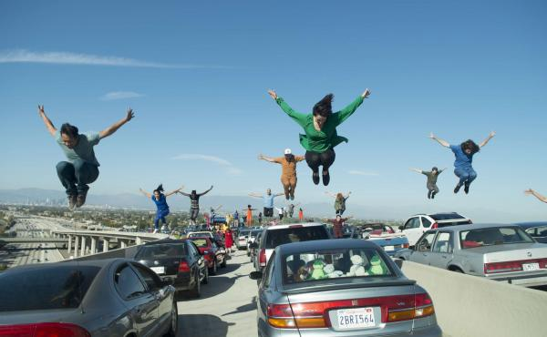 Choreographer Mandy Moore was lying underneath a car on the LA freeway, counting and calling out steps, throughout the 47 takes it took to shoot La La Land's fun-filled opening scene.