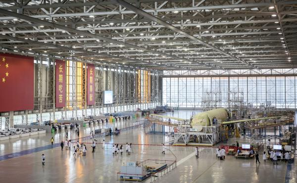 "A Commercial Aircraft Corp. of China Ltd. C919 aircraft stands under assembly in Shanghai in 2017. Proposed U.S. tariffs take special aim at the ""Made in China 2025"" plan, which supports development of advanced technologies in fields such as artificial in"