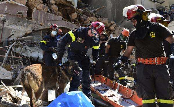 Search and rescue workers sift through damaged buildings Thursday in Beirut after this week's huge explosion at the Lebanese capital's port caused widespread damage.