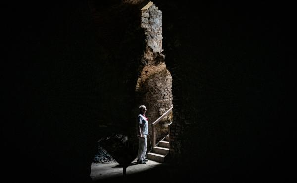 Archaeologist Ferudun Ozgumus stands in what is believed to be a Byzantine-era substructure in Istanbul.
