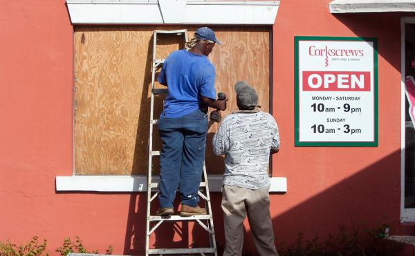 Workers board up a restaurant Thursday in Flatts Village as Bermudans prepare for the arrival of Hurricane Gonzalo. The storm will hit the island Friday.
