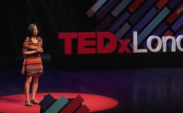 Beth Gardiner speaks on the TEDx stage in London.