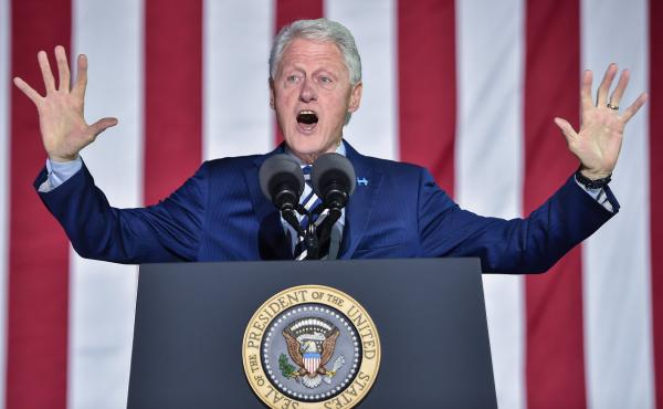 Former President Bill Clinton gestures to the crowd during a campaign stop in Philadelphia for his wife, Hillary, on the day before the 2016 presidential election.