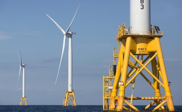 Three of Deepwater Wind's turbines stand off Block Island, R.I., in 2016. The Biden administration is pushing for a sharp increase in offshore wind energy development along the East Coast.