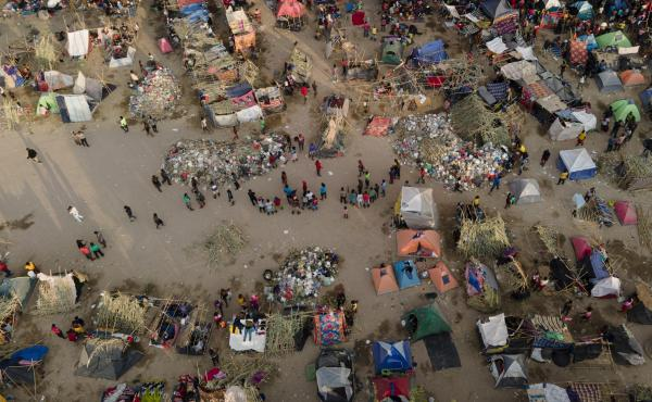 Migrants, many from Haiti, are seen at an encampment along the Del Rio International Bridge near the Rio Grande on Tuesday.