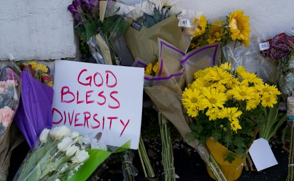Flowers and signs adorn Gold Spa in Atlanta during a demonstration on Thursday opposing violence against women and Asians following this week's deadly shootings in the area.