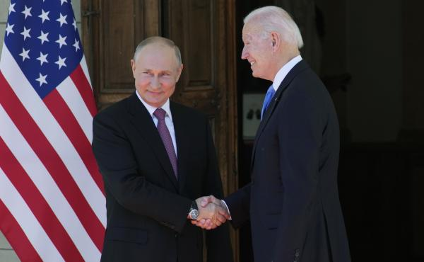 Russian President Vladimir Putin and President Biden shake hands during their meeting at the Villa la Grange in Geneva on Wednesday.