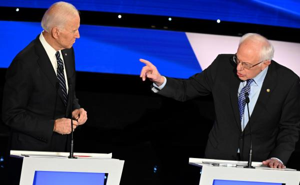 Former Vice President Joe Biden, left, and Vermont Sen. Bernie Sanders participate in a Democratic presidential primary debate in Des Moines, Iowa, on Jan. 14. The two septuagenarians have sparred in recent days about Social Security.