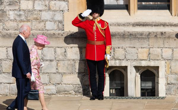 Queen Elizabeth II and President Biden walk at Windsor Castle on Sunday in Windsor, England. This is Biden's first private meeting with Queen Elizabeth II since becoming president.