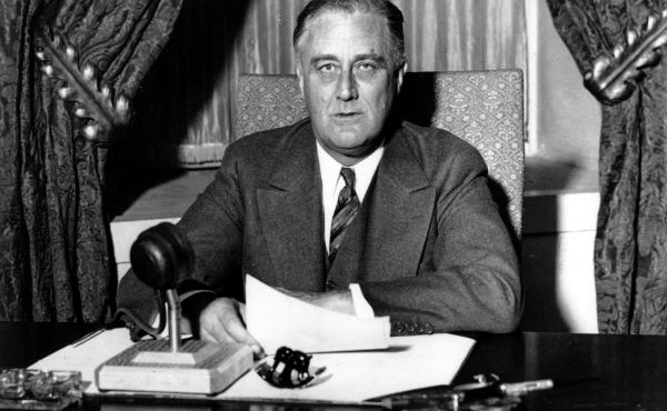 """This photo was taken moments before U.S. President Franklin D. Roosevelt began his historic """"Fireside Chat"""" to the American people on March 12, 1933. President Biden is reviving the practice, used by many modern presidents but ditched by Trump, of directl"""