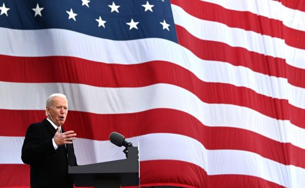 President-elect Joe Biden speaks Tuesday at a National Guard/Reserve Center in New Castle, Del., named after his late son, Beau, before departing for Washington, D.C.