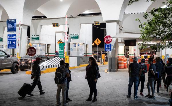 Migrants are greeted by Taylor Levy (center), a local immigration attorney, at the Paso del Norte International Bridge in April 2020 in Ciudad Juarez, Mexico. People seeking asylum were enrolled in the Migrant Protection Protocols program, better known as