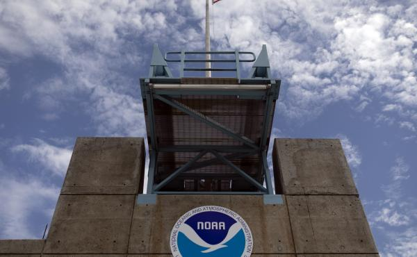 The logo of National Oceanic and Atmospheric Administration is seen at the Nation Hurricane Center in Miami on Aug. 29, 2019. President Biden has nominated Rick Spinrad to head NOAA.